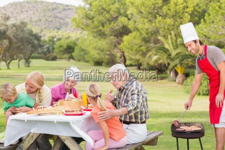happy family at picnic table with
