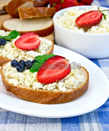 bread with curd and berries on