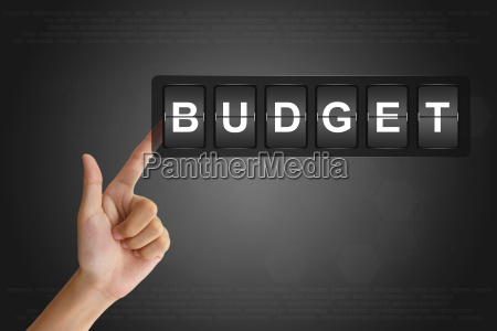 hand pushing financial budget on flip
