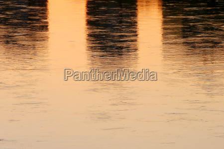 close up of sunset water reflection
