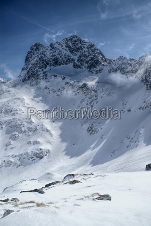 berge winter verschneit sonnenlicht outdoor freiluft