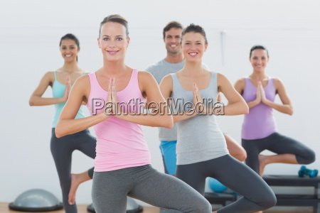 sporty class with joined hands in