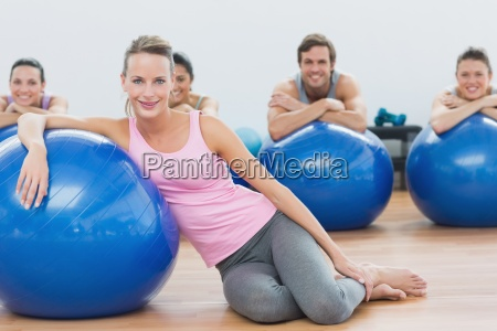 instructor and class with exercise balls