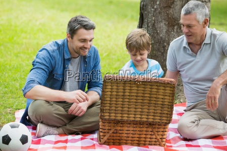 grandfather father and son with picnic