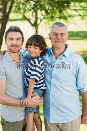 grandfather father and son smiling at