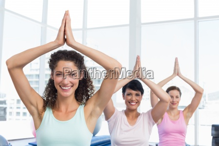 sporty women with joined hands over