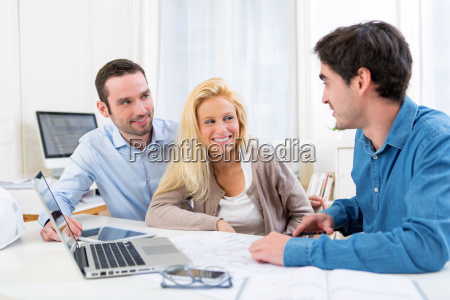 young serious couple meeting a real