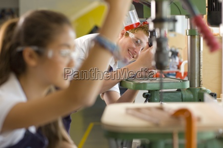 serious students using drill in vocational