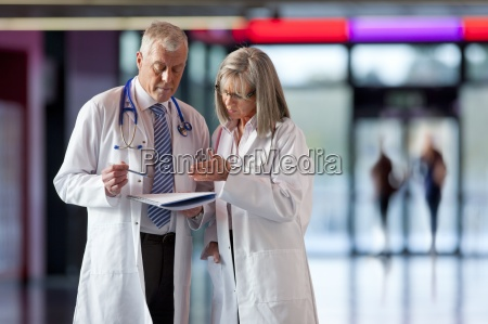 doctors looking at paperwork together in