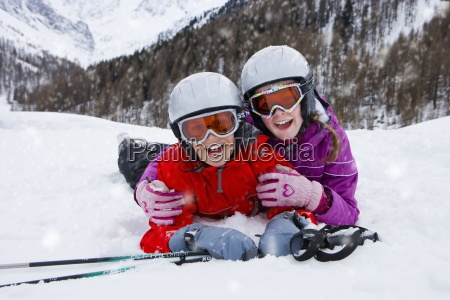 boy and girl wearing helmets and