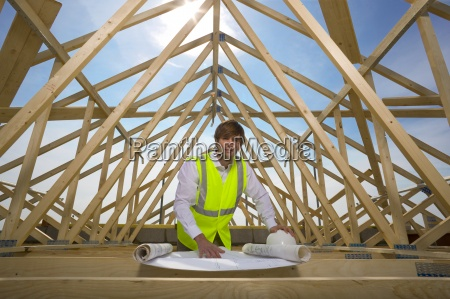 portrait of architect with blueprints at