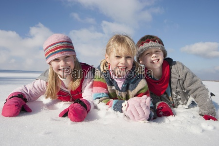 portrait of smiling boy and girls