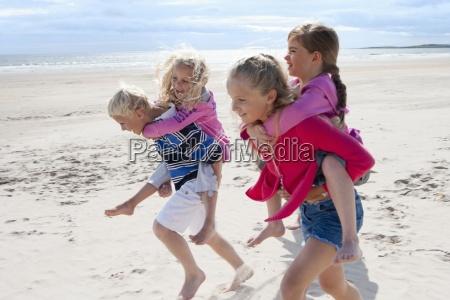 kids running and piggybacking on sunny