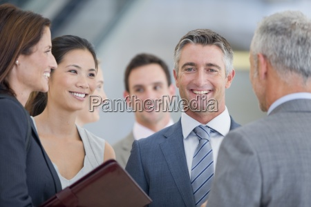 portrait of smiling businessman among co