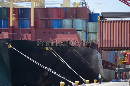 container ship being unloaded at commercial