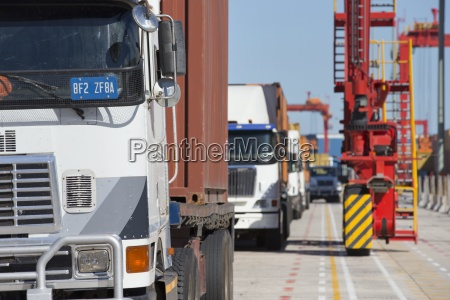 lorries with cargo containers at commercial