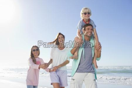 happy family on sunny beach