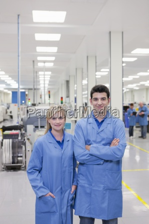 portrait of smiling technicians in lab