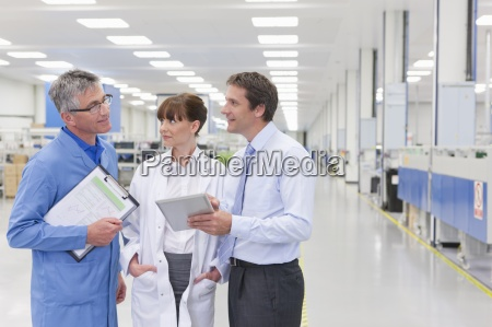 scientist technician and businessman meeting in