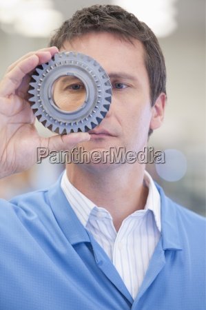 close up of engineer examining machine