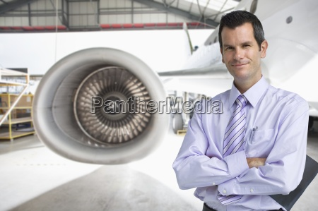 portrait of confident businessman with arms