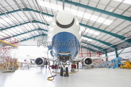 passenger jet in hangar