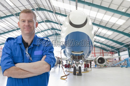 portrait of confident engineer near passenger