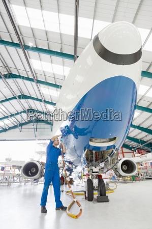 engineer working on passenger jet in