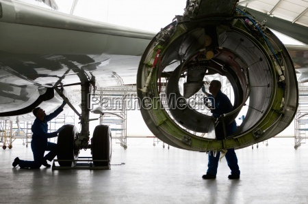 engineer inspecting engine casing on passenger