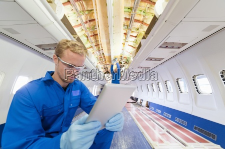 engineer with digital tablet inside empty