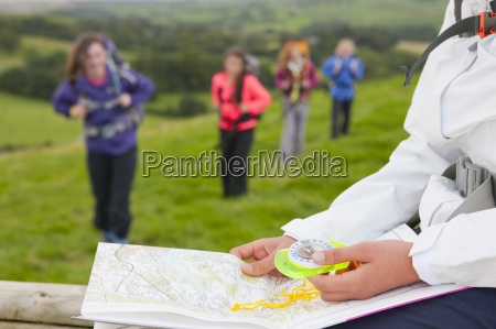 close up of girl holding compass