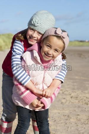 portrait of smiling girls hugging on