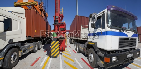 cargo containers on lorries at commercial