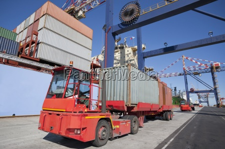 lorry hauling cargo containers at commercial
