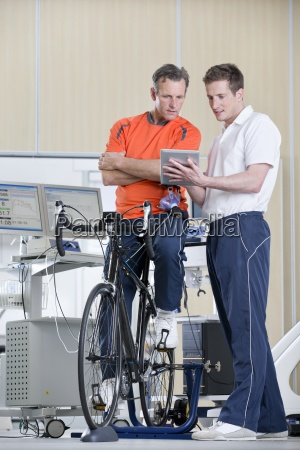 sports scientist and cyclist on exercise