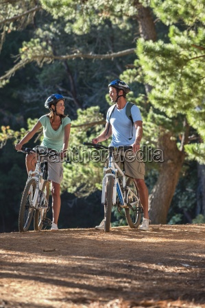 happy couple on mountain bikes in