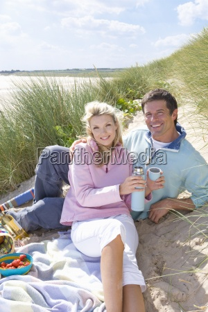 portrait of young couple having picnic