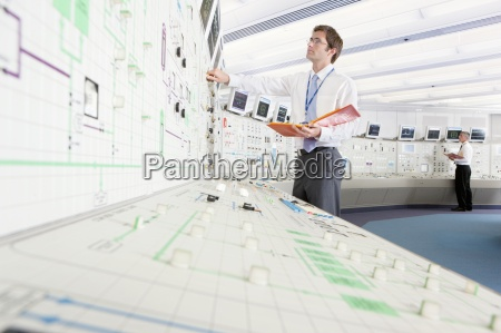 engineer with binder looking up at
