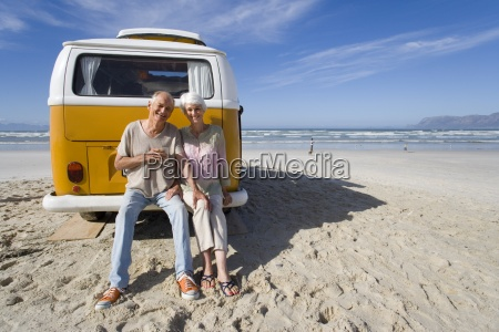 senior couple sitting on back of