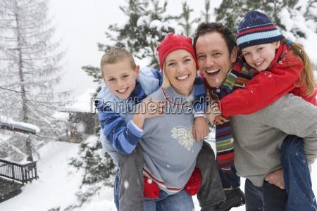 portrait of happy family in winter