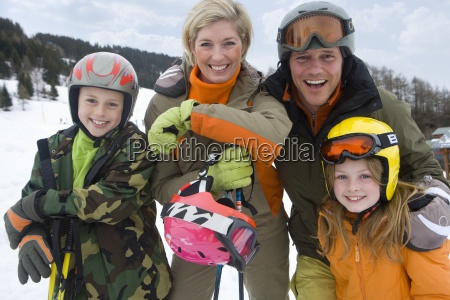 portrait of young family in ski
