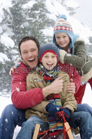 portrait of father and children sitting