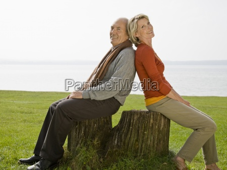 a senior couple sitting back to