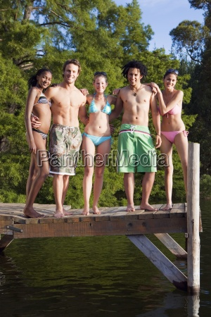 five young adults in swimwear standing