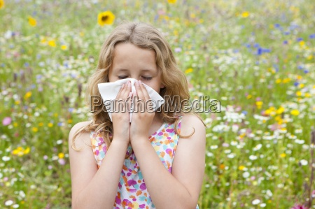 girl standing in field of wildflowers