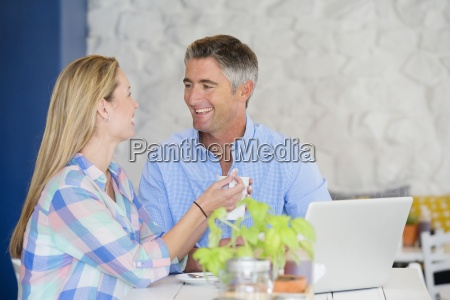 couple drinking coffee at table