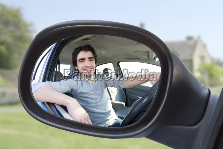 portrait through the rear view mirror