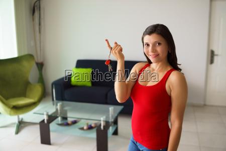 portrait female home owner smiling holding