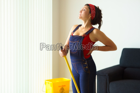 portrait woman doing chores cleaning floor