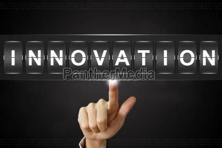 business hand clicking innovation on flipboard